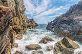 Ocean waves crashing against a rocky shore- slow shutterspeed