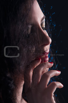 beautiful fashionable woman in black background
