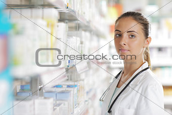 Portrait of Smiling Woman Pharmacist in Pharmacy