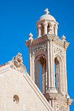 High church bell tower opposite blue sky