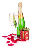Two champagne glasses, christmas decor and rose petals
