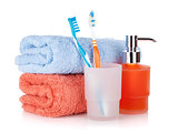 Toothbrushes, liquid soap and towels