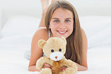 Cute young girl holding a teddy bear