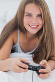 Portrait of a young girl playing video games