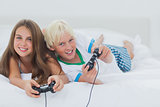 Cheerful siblings playing video games