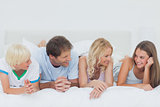 Family lying on the bed