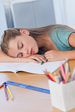 Little girl sleeping on books