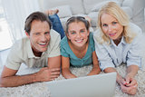 Portrait of parents and daughter using a laptop
