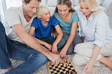 Portrait of a cheerful family playing chess