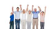 Smiling family raising their arms