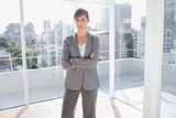 Confident businesswoman in bright office