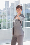 Succesful businesswoman giving thumb up
