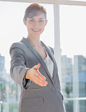 Businesswoman smiling with hand out