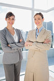 Confident businesswomen smiling at camera