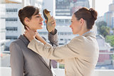 Businesswoman strangling another who is defending with her shoe