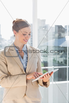 Beautiful businesswoman using her tablet pc