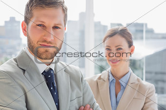 Smiling business partners looking at camera
