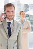 Happy businessman having phone conversation