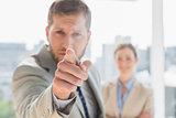 Angry businessman pointing at camera