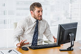 Frustrated businessman looking at his computer