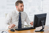 Serious businessman looking at computer