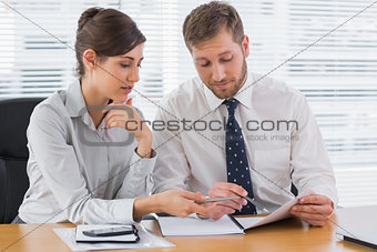 Business people going over documents