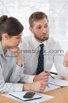 Business people chatting over documents