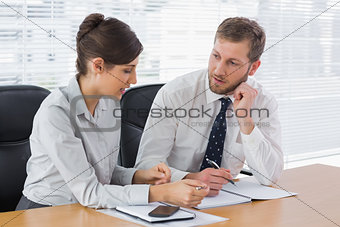 Business team working together on documents