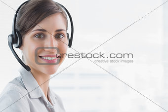 Call centre agent smiling at camera
