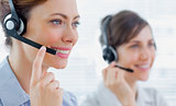 Call centre agents with headsets at work