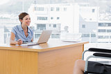 Businesswoman smiling at disabled interviewee