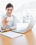 Pretty businesswoman showing blank business card