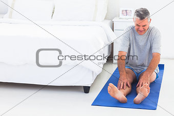 Man working out on an mat