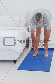 Man stretching on a mat