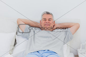 Man relaxing in bed