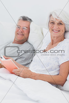 Couple reading together in bed