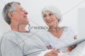 Cheerful mature couple using a laptop together