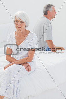 Angry woman sulking in bed during a conflict