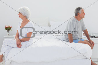 Mature woman sulking in bed during a conflict