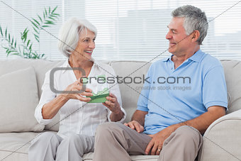 Man giving a present to wife