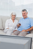 Couple watching television on the couch