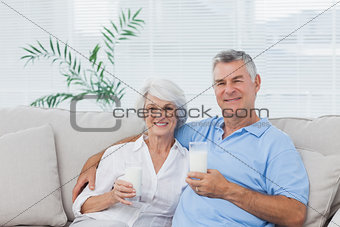 Couple drinking glasses of milk