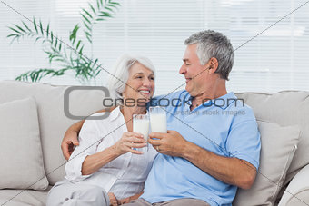 Couple clinking glasses of milk