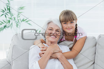 Little girl hugging her grandmother