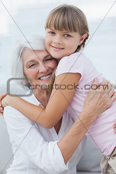 Cute girl hugging her grandmother