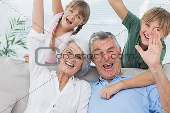 Grandchildren and grandparents raising their arms