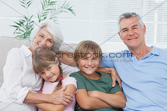 Portrait of grandparents with their grandchildren