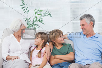 Grandparents speaking with their grandchildren