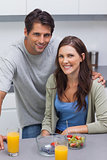 Smiling couple sitting in kitchen