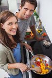 Couple cooking vegetables in the kitchen